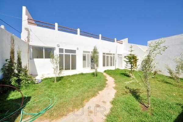 Lumineuse maison avec jardin